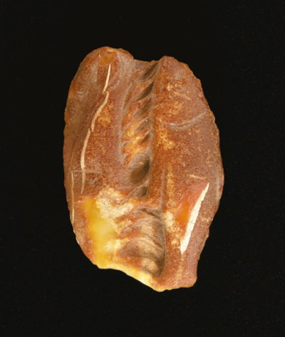 A ROMAN AMBER CARVING