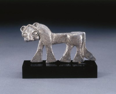 A CASPIAN SILVER LION ATTACHME