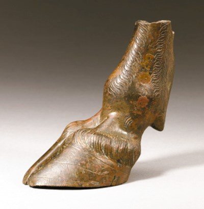 A SOUTH ARABIAN BRONZE HOOF OF