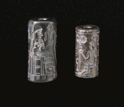 TWO SYRIAN HAEMATITE CYLINDER