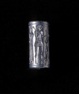 A CYPRIOT HAEMATITE CYLINDER S