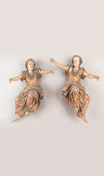 A PAIR OF SOUTH GERMAN POLYCHROME AND PARCEL GILT SEATED FIGURES OF ANGELS