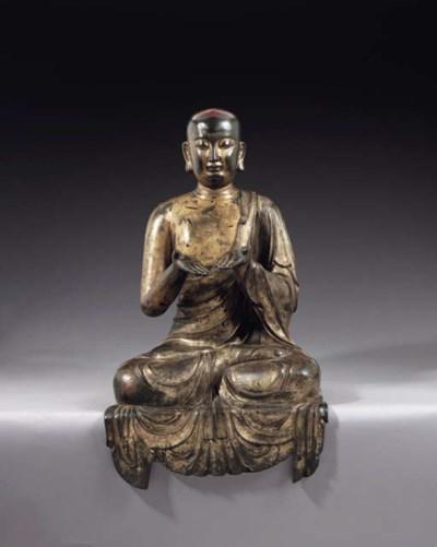 A Rare Gilt-Bronze Figure of a
