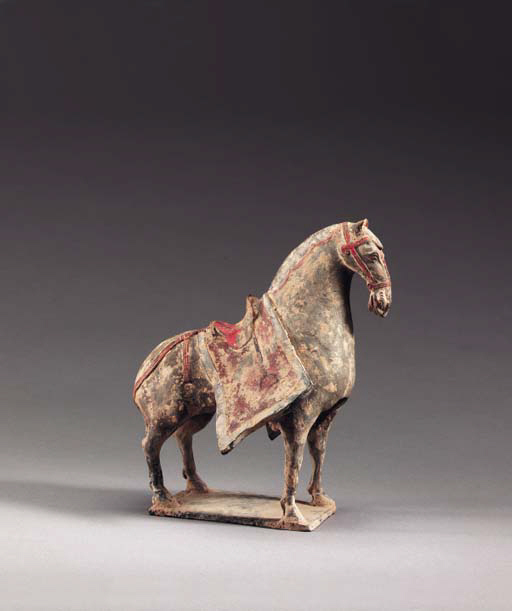 A Painted Grey Pottery Figure of a Caparisoned Horse