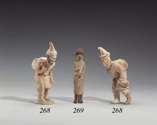 Two Painted Pottery Figures of Semitic Merchants