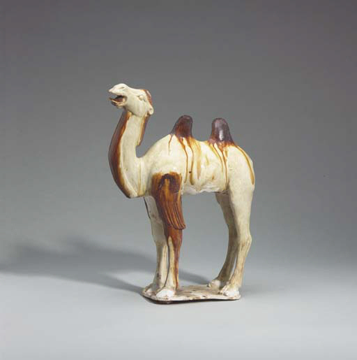 A Cream and Amber-Glazed Pottery Figure of a Camel