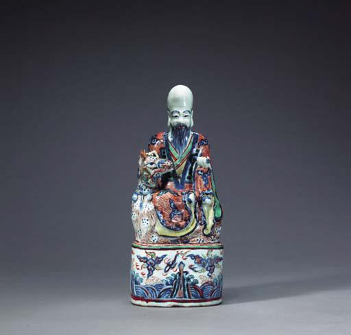 An Unusual Wucai Figure of Shoulao with a Deer