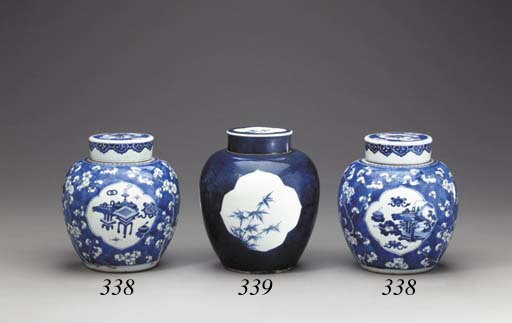 A Pair of Blue and White Ovoid Jars and Covers
