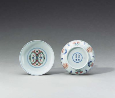 A Pair of Small Enameled Sauce