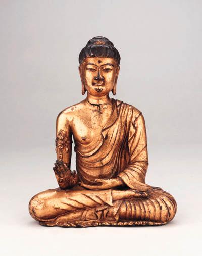 A Rare and Important Gilt Bronze Figure of Buddha Shakyamuni