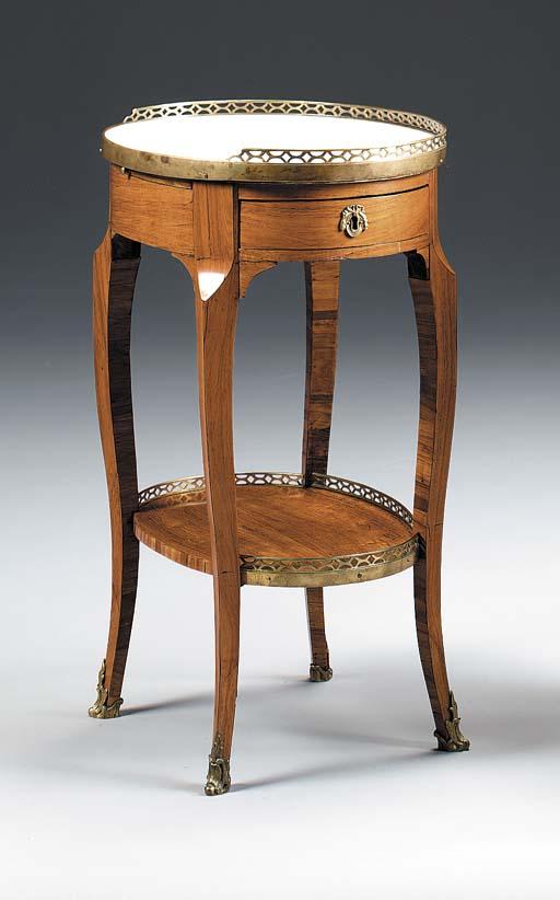 A LOUIS XV/XVI TULIPWOOD TABLE