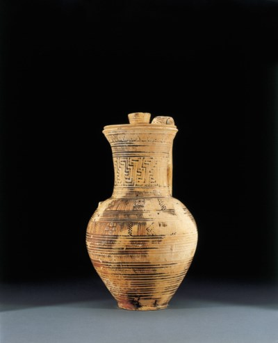 A GEOMETRIC PITCHER WITH LID