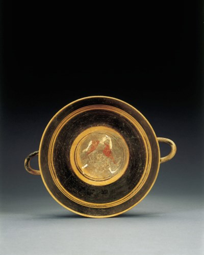 AN ETRUSCAN LIP-CUP WITH SUPER