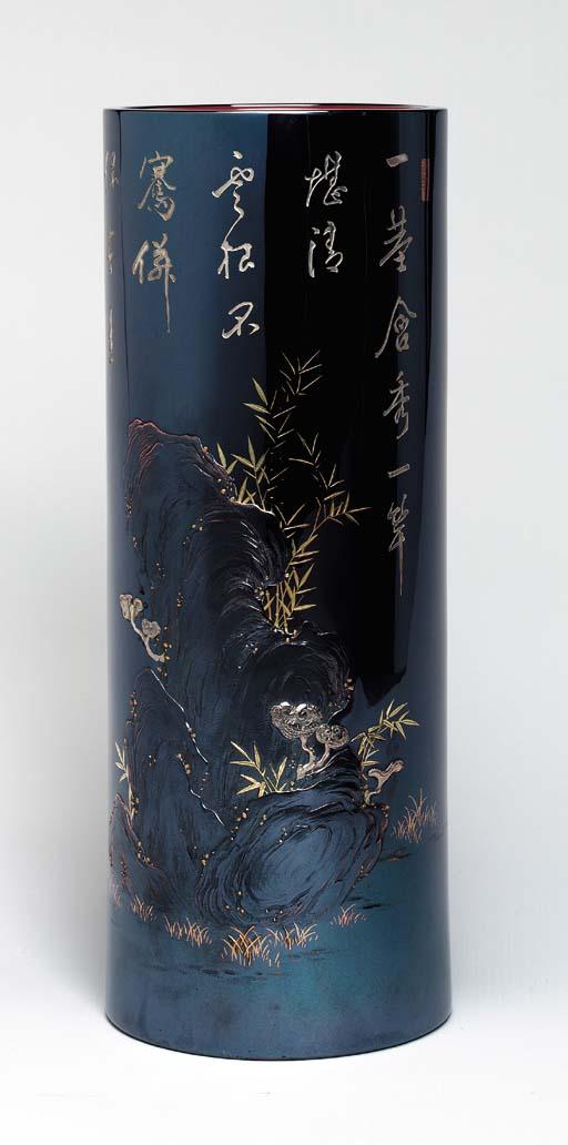 A Tall and Engraved Shakudo Fl