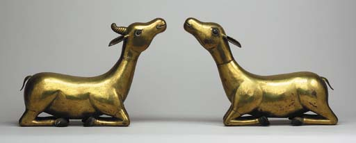 A Large Pair of Gilt Copper Ré
