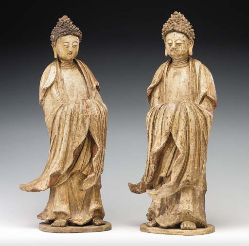 A Pair of Painted Stucco Figur