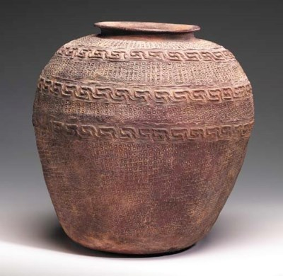 A Large Dark Red Pottery Ovoid