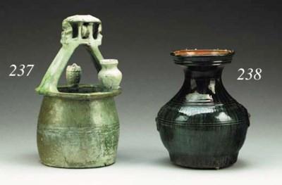 A Large Green-Glazed Pottery M