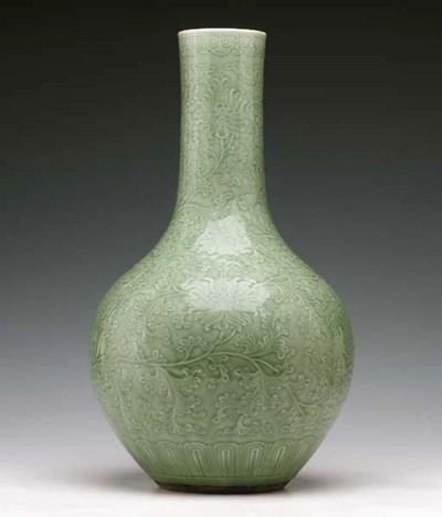 A Large Celadon-Glazed Carved