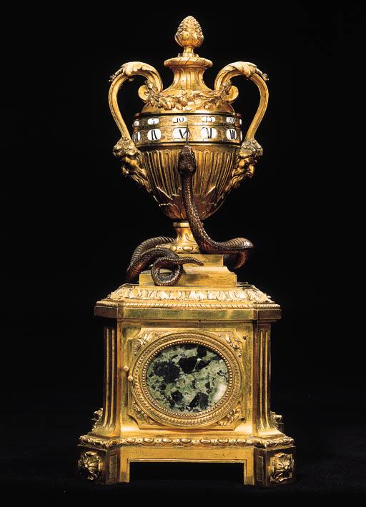 A LOUIS XV/LOUIS XVI ORMOLU, BRONZE AND VERDE ANTICO MARBLE URN CLOCK