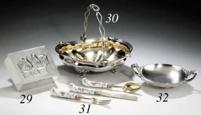 A set of silver-gilt and porce