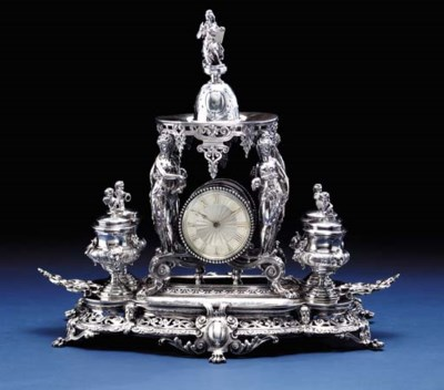 A FRENCH SILVER CLOCK INKWELL