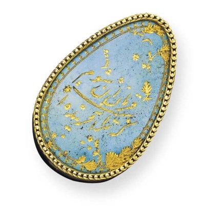 A TURQUOISE AND GOLD PAPERWEIG