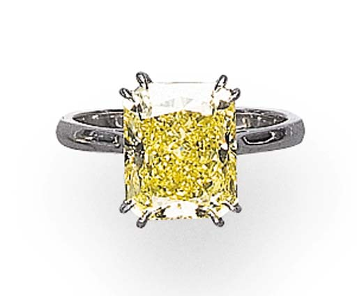A SINGLE-STONE FANCY INTENSE YELLOW DIAMOND RING
