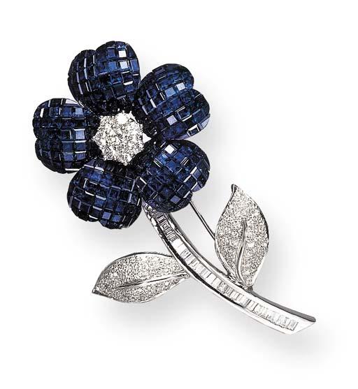 A SAPPHIRE AND DIAMOND FLOWER BROOCH