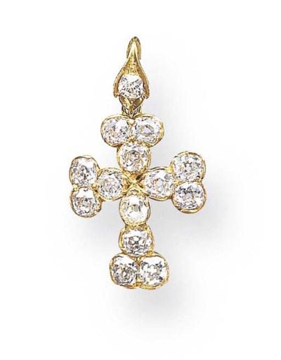 A DIAMOND AND GOLD CROSS PENDA