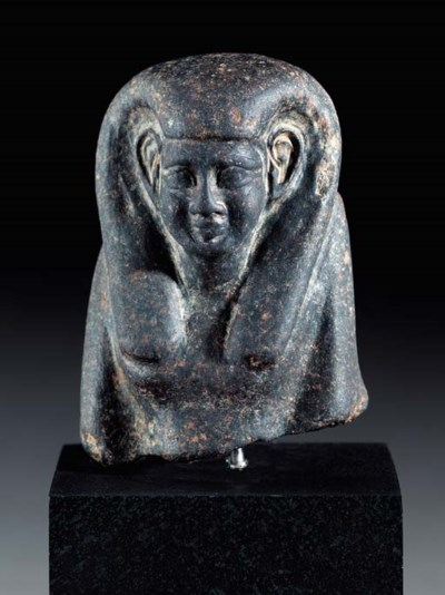 AN EGYPTIAN GRANITE BUST OF A