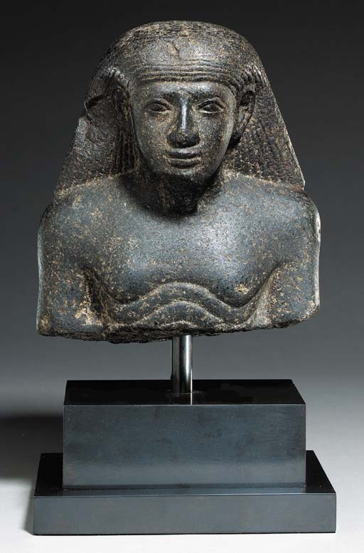 AN EGYPTIAN GRANITE BUST OF AN