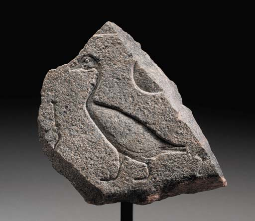 AN EGYPTIAN GRANITE RELIEF