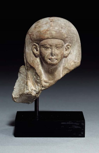 AN EGYPTIAN LIMESTONE HEAD FRO