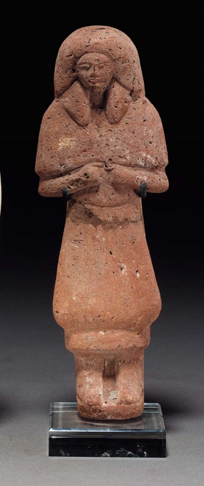 AN EGYPTIAN POTTERY SHABTI