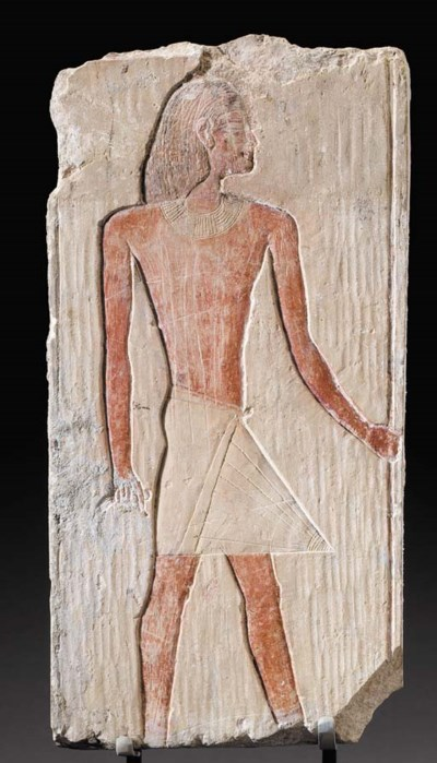 AN EGYPTIAN LIMETONE RELIEF
