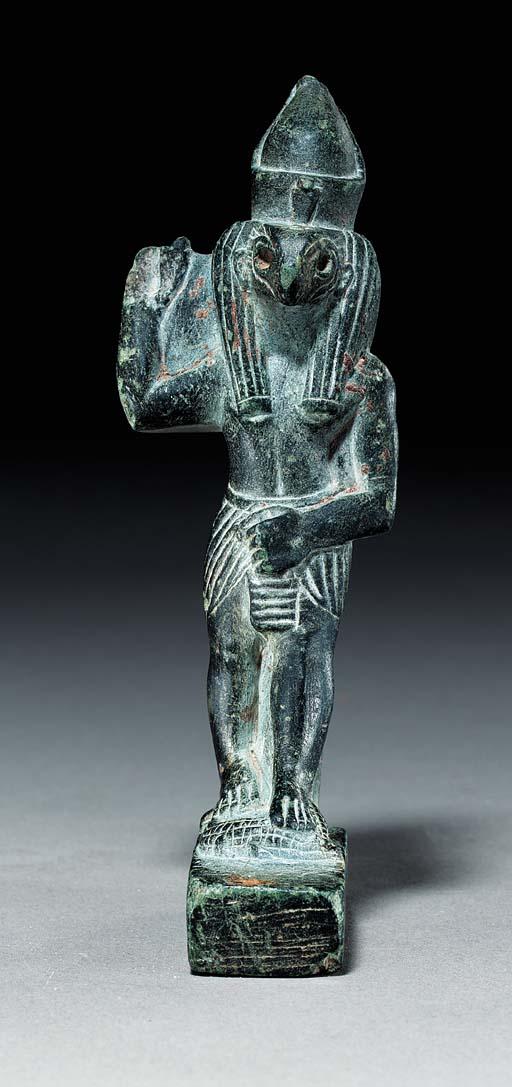 AN EGYPTIAN GRAYWACKE FIGURE O