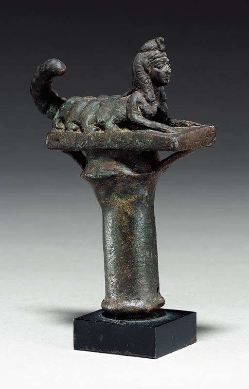AN EGYPTIAN BRONZE FINIAL OF S
