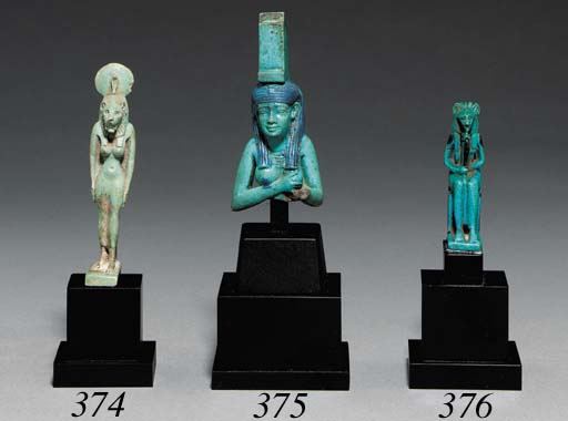 AN EGYPTIAN FAIENCE LION-HEADE