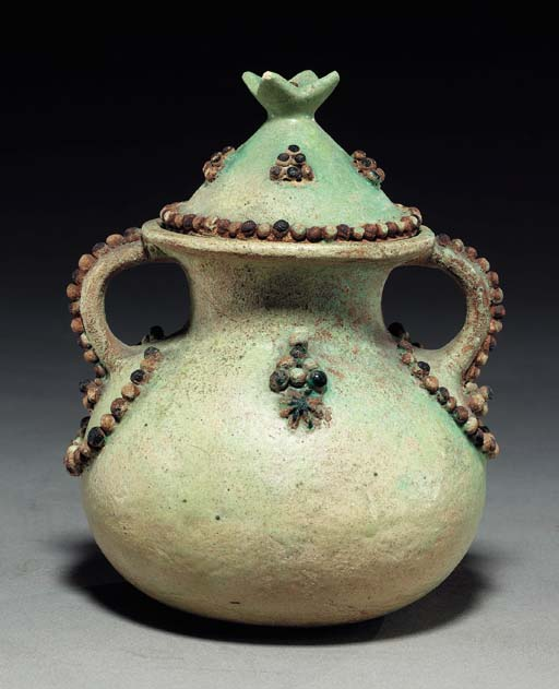 AN EGYPTIAN FAIENCE VESSEL AND