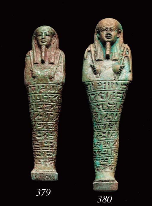 AN EGYPTIAN FAIENCE SHABTI