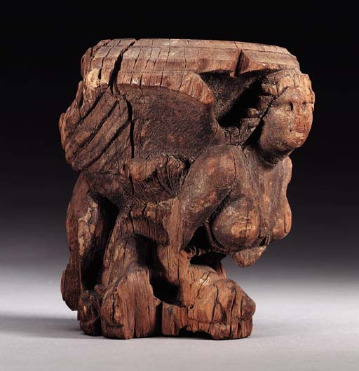 AN EGYPTIAN WOODEN SPHINX