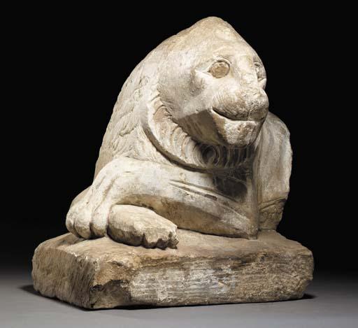 AN EGYPTIAN LIMESTONE LION