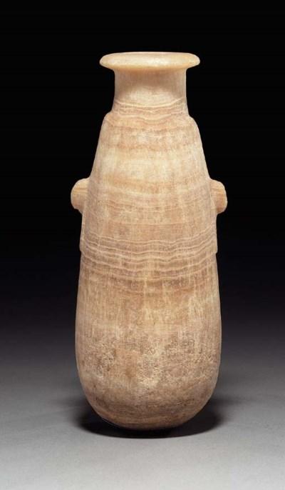 AN EGYPTIAN ALABASTER ALABASTR