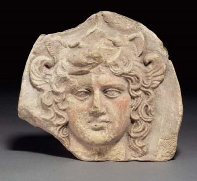 A GREEK TERRACOTTA ANTEFIX