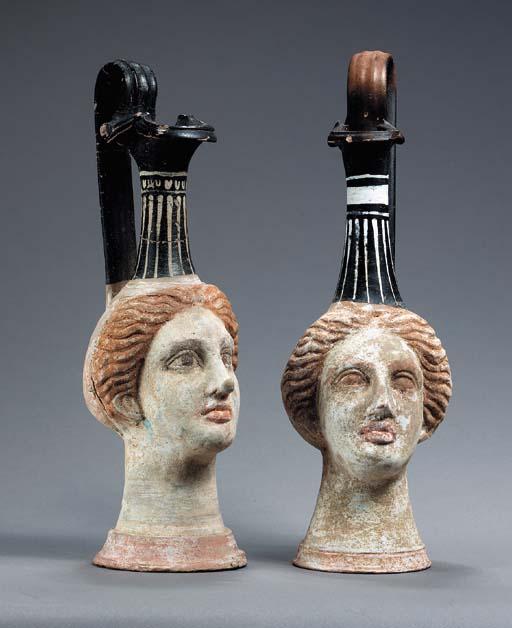 TWO GREEK POTTERY HEAD OINOCHO