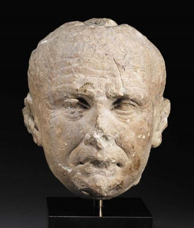 A ROMAN LIMESTONE PORTRAIT OF