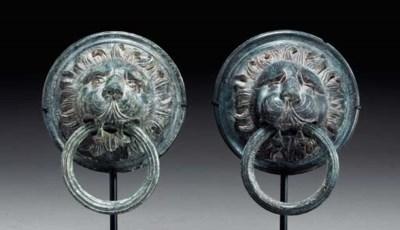 A PAIR OF ROMAN BRONZE LION HE