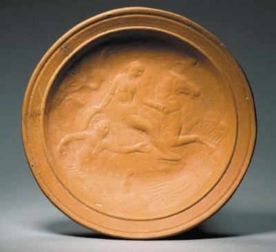A ROMAN RED SLIP WARE PLATE
