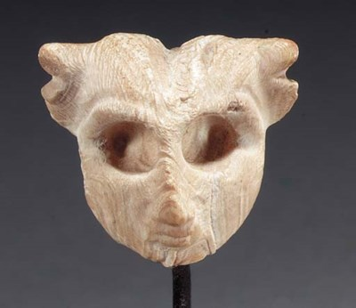 A SUMERIAN SHELL AMULET